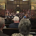 Orchestra & choir performing2
